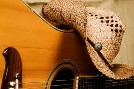 country music guitar and cowboy hat
